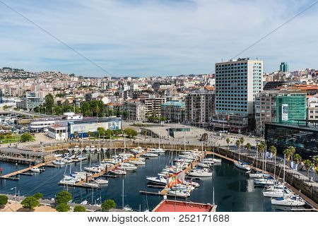 Vigo, Spain - May 20, 2017: Cityscape Of Vigo With Moored Yachts In The Foreground In Port Of Vigo,