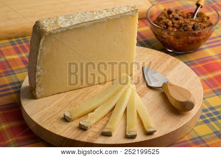French Cantal aop cheese on a cutting board as dessert