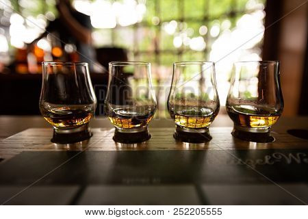 Bourbon Flight With Selective Focus On Four Samples