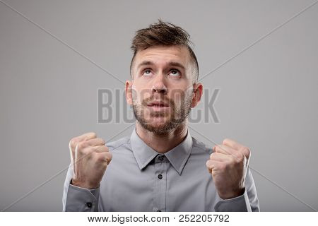 Intense Bearded Young Man Clenching His Fists