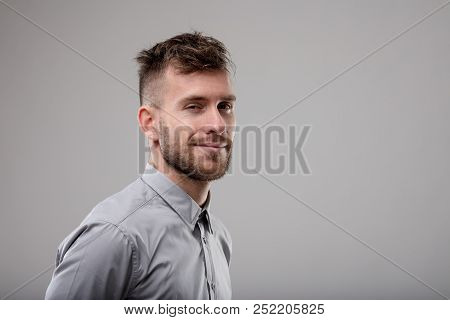 Sexy Bearded Man Giving The Camera A Sultry Smile