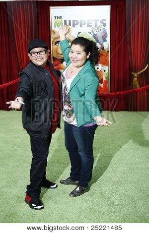 LOS ANGELES - NOV 12: Rico Rodriguez; Raini Rodriguez at the world premiere of 'The Muppets' held at the El Capitan Theater on November 12, 2011 in Los Angeles, California