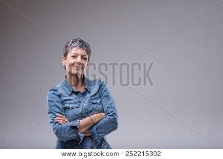 Confident Senior Woman With Folded Arms