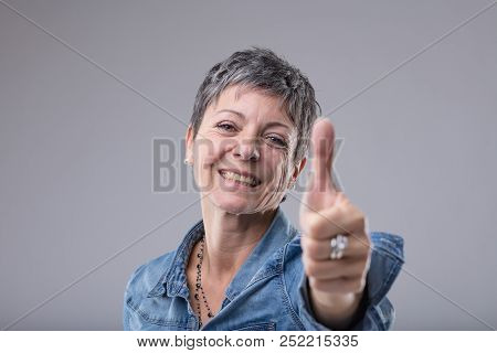 Happy Enthusiastic Lady Giving A Thumbs Up
