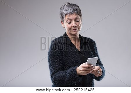 Senior Woman Reading A Text Message On A Mobile