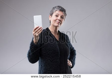 Attractive Self-assured Woman Holding A Mobile