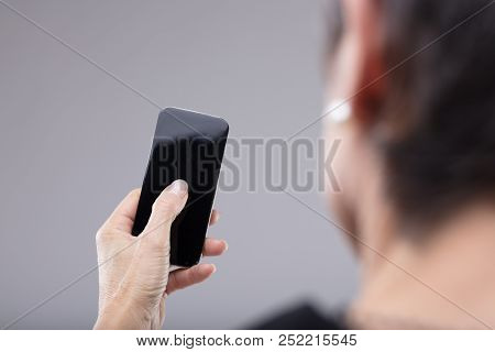 Woman Holding A Blank Mobile Phone In Her Hand