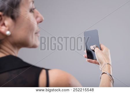 Stylish Woman Holding A Mobile In Her Hand