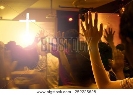 Praise And Worship Concept:hands Raised In Excitement And Praise At Contemporary Church Concert And