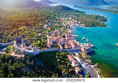 Mali Ston waterfront aerial sun haze view, Ston walls in Dalmatia region of Croatia poster