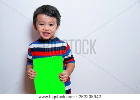 Smiling Face Of Asian Young Boy On White Background. Stock Photo
