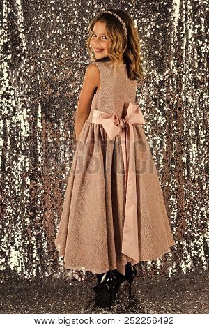 Look, hairdresser, makeup. Little girl in fashionable dress, prom. Fashion model on silver background, beauty. Child girl in stylish glamour dress, elegance. Fashion and beauty, little princess. poster