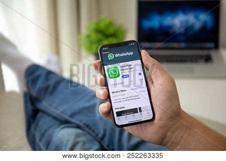 Alushta, Russia - July 29, 2018: Man Holding Iphone X With Social Networking Service Whatsapp On The