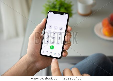 Alushta, Russia - July 28, 2018: Man Hand Holding Iphone X With Call Number On The Screen. Iphone 10