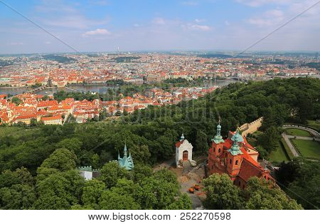 Panoramic Aerial View Of Prague, Czech Republic With St Lawrence Church Near Petrin Tower In Foregro