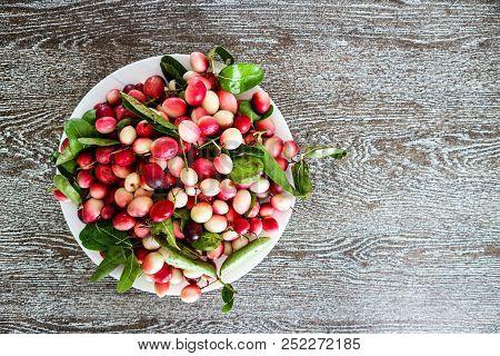 Carunda Or Karonda Fruit On Dish And Hard Wood Background