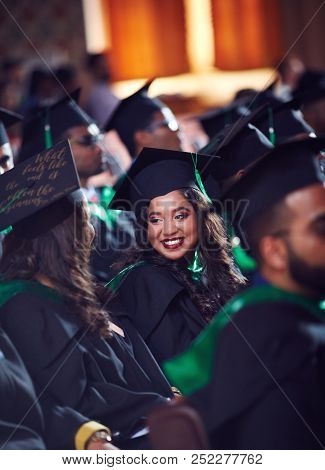 Group Of Happy Graduate Students In Gowns On Graduation Ceremony