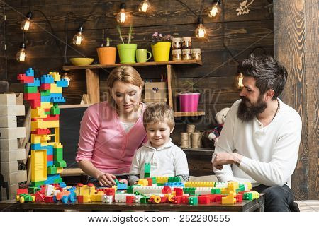 Building Concept. Little Son With Mother And Father Play With Building Blocks. Building Social Skill