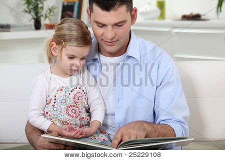 young father reading his daughter story