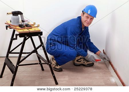 professional repairman working on a wall