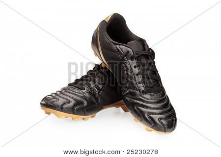 Pair of black leather soccer shoes isolated on white background