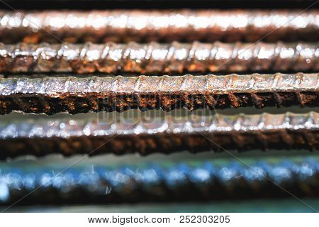Old Rusty And Wet Iron Grate In Close Up Picture. Wet Iron Fence Background At Prison. Vintage Old M