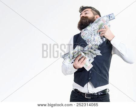 Corruption. Portrait Of Corrupt Businessman Hiding Money In His Jacket. Bearded Man Putting Money In