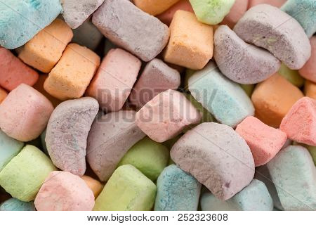 Close Up On Variety Of Small Rainbow Colored Crescent Shaped Tasty Sugar Candies. Includes Copy Spac