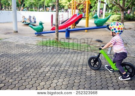 Cute Little Asian 2 Years / 30 Months Old Toddler Boy Wearing Safety Helmet Learning To Ride First B