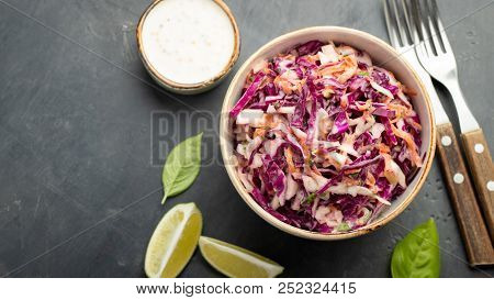 Purple Cabbage And Carrot Salad With Mayonnaise In A White Bowl On A Black Background. Classic Coles