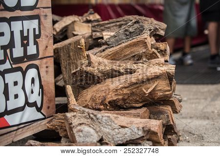 Mesquite Wood Logs Stacked Neatly And Ready For The Smoker Grill For Bareque Flavored Meat.