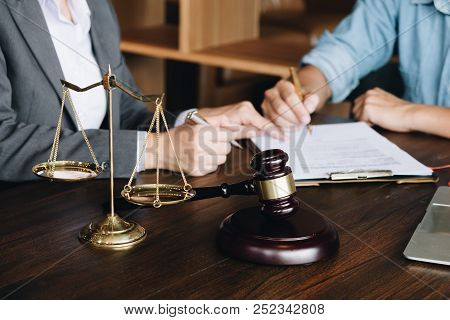 Judge Gavel With Justice Lawyers, Business People And Lawyers Discussing About Agreement Papers And