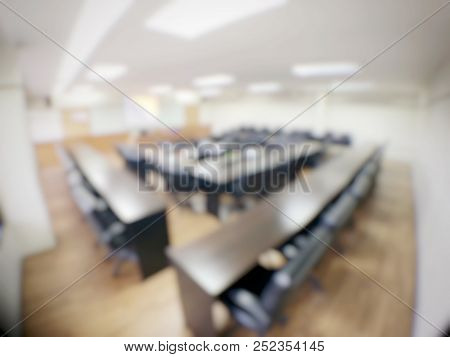 Blurred Image Of Empty  Meeting Room, Conference Room, Board Room With Rustic Wooden Flooring, Meeti