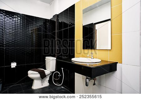 Generic Toilet Room Of Apartment Or Small Hotel Decoration With Glossy Ceramic In Black And Yellow W