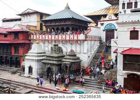 KATHMANDU, NEPAL - JULY 12, 2018: Temple crematorium Pashupatinath.  People believe that cremation will give a spiritual rebirth