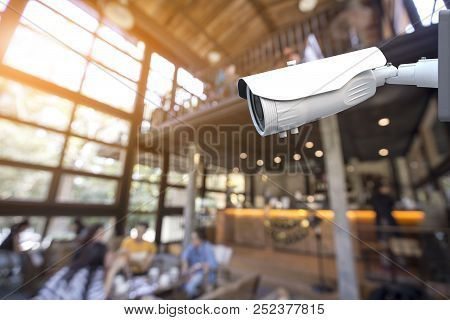 Security Cctv Camera Operating In Coffee Shop Cafe And Restaurant Interior Background