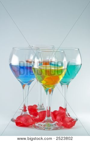 Four Wine Glasses With Rose Pedals