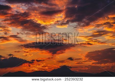 Beautiful Colorful Sunset And Orange Couds. Mountain Landscape Silhouette.