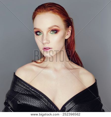 Sexy Nude Beautiful Redhead Girl With Long Hair. Perfect Woman Portrait On Dark Background. Makeup,