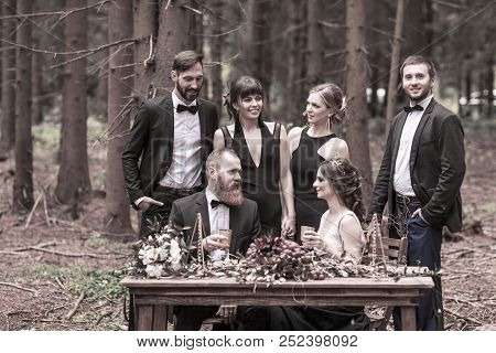 Married And The Witnesses At The Picnic In The Woods