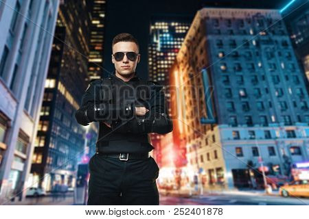 Police officer in sunglasses, night city