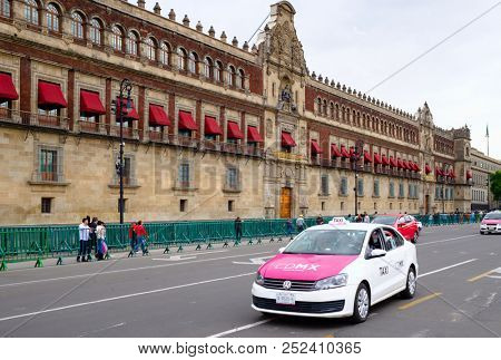 MEXICO CITY,MEXICO - JULY 12,2018 :  Typical pink taxis next to the National Palace in the historical center of Mexico City