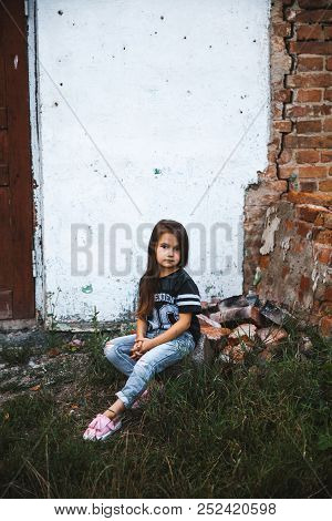 Beautiful Little Girl In Ragged Jeans.fashion Child A