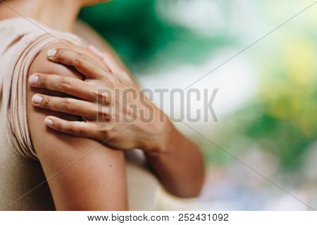 Woman With Pain In Shoulder And Upper Arm. Ache In Human Body