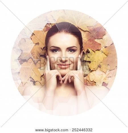 Beautiful Face Of Young, Natural And Healthy Woman Over Fallen Leaves. Healthcare, Spa, Makeup And F