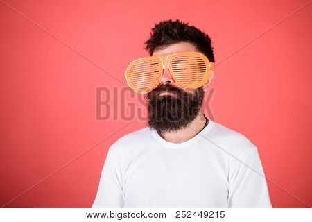 Optics And Eye Protection Concept. Sunglasses Party Attribute And Stylish Accessory. Man Bearded Hip
