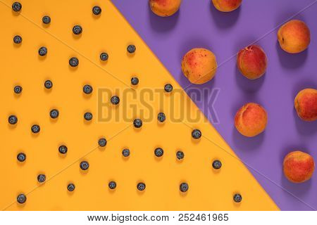 Many Juicy Beautiful Amazing Nice Peaches And Blueberries On Violet And Yellow Surface. Beautiful Fo