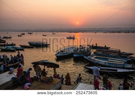 VARANASI, INDIA - MAR 21, 2018: Banks on the holy Ganges river in the early morning. According to legends, Varanasi was founded by God Shiva about 5000 years ago.