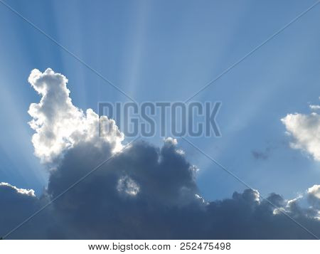 Sun Rays Shine Through A Cloud In A Short Wave That Is Trying To Develope In The Atmosphere. Note Cl