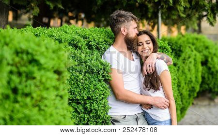 Couple In Love Romantic Date Walk Nature Park Background. Man Bearded Hipster Hugs Gorgeous Girlfrie